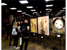 Attendees enjoying the art exhibited