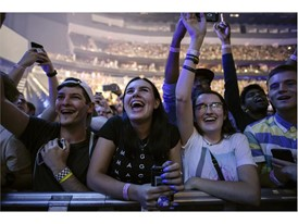 Fans cheer as Imagine Dragons performs