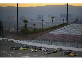 Dusk falls on Las Vegas and the Strip as the field heads into turn one during the NASCAR Camping World Truck Series
