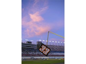 The setting sun illuminates clouds during the NASCAR Camping World Truck Series