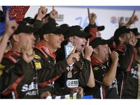 Ben Rhodes and his team cheer for photos after winning the NASCAR Camping World Truck Series