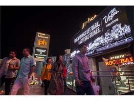 Visitors walk along Las Vegas Strip