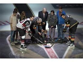 Survivors of the October 1st tragedy participate in a puck drop