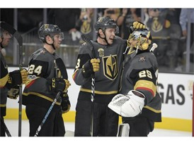 Vegas Golden Knights defenseman Brayden McNabb (3) congratulates Vegas Golden Knights goalie Marc-Andre Fleury (29)