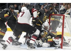 Vegas Golden Knights goalie Marc-Andre Fleury (29) gets shoved into his net while making a save