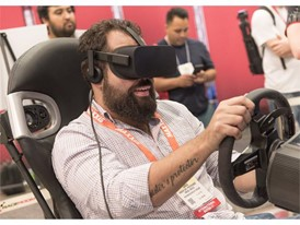 Andres Garcia of Merida, of Mexico, enjoys a virtual reality race