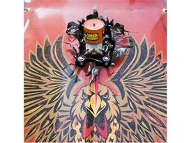 A carburetor seems to burst through the hood of a vintage Firebird at the Specialty Equipment Market Association (SEMA)