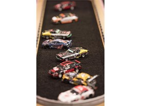 "Slot cars are parked in the ""infield"" of a race track at the Specialty Equipment Market Association (SEMA) Show"
