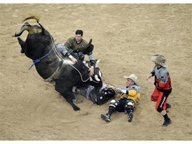 Lachlan Richardson is helped by bullfighters from left, Cody Webster, Frank Newsom and Shorty Gorman