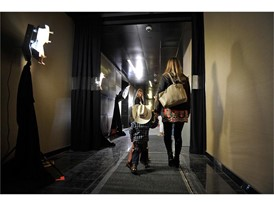 A young cowboy is escorted through the halls during the PBR World Finals