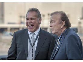 Former Oakland Raiders great Jim Plunkett, left, and coach Art Flores