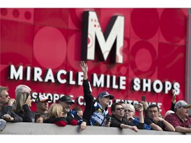 Fans line the sidewalk outside the Miracle Mile Shops during the NASCAR Victory Lap