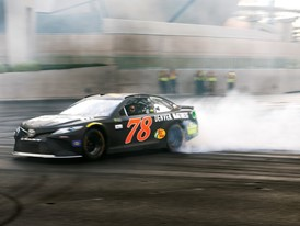 Martin Truex Jr. does a burnout at the intersection of the Strip and Harmon Avenue