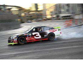 Austin Dillon does a burnout at the intersection of the Strip and Harmon Avenue