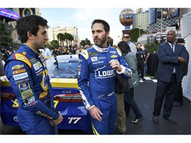 NASCAR Cup Series driver Jimmie Johnson, right, talks with Chase Elliott
