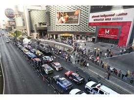Stock cars are lined up outside Planet Hollywood and the Miracle Mile Shops
