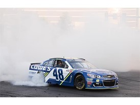 Jimmie Johnson and his #48 Hendrick Motorsports Lowe's Chevrolet SS is shrouded in smoke