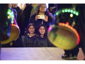 Kids watch performances onstage at the LINQ's annual tree lighting ceremony