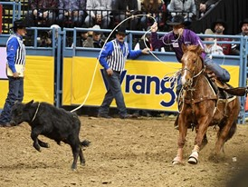 Timber Moore from Aubry, Texas, competes in tie-down roping