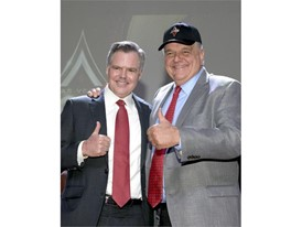 Jim Murren (l) Chairman and CEO of MGM Resorts International and Clark County Commissioner Steve Sisolak, wearing the ne