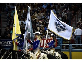 A Vegas Strong flag is carried into the arena during the seventh go-round of the National Finals Rodeo