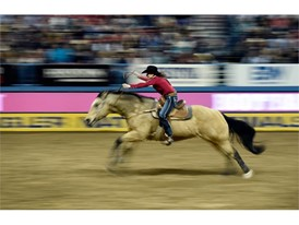 Lisa Lockhart from Oelrichs, South Dakota, competes in barrel racing during the seventh go-round of the National Finals