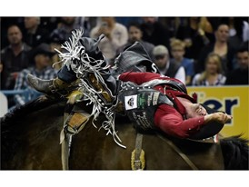 Steven Dent from Mullen, Nebraska, competes in bareback riding during the seventh go-round of the National Finals Rodeo