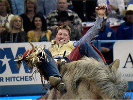Ty Breuer from Mandan, North Dakota, competes in bareback riding the seventh go-round of the National Finals Rodeo