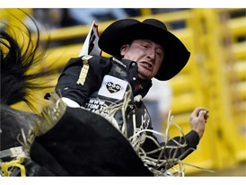 Jake Vold from Ponoka, Alberta, Canada, competes in bareback riding in the seventh go-round of the National Finals Rodeo