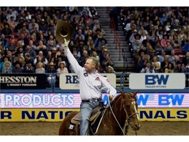 Brady Minor acknowledges the crowd after competing in the team roaring during the seventh go-round of the National Final