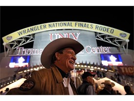 Delbert Warren of Oklahoma is all smiles before as he arrives for the seventh go-round of the National Finals Rodeo