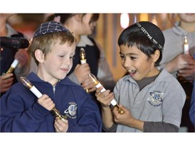 Students of the Desert Torah Academy's Children's Choir during a menorah lighting ceremony