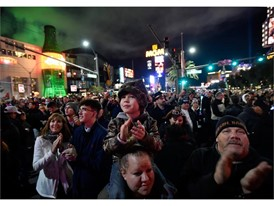 Revelers of all ages celebrate New Year's Eve along the Las Vegas Strip