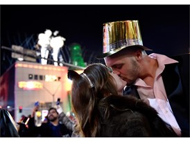 Breanna Vereeke and Graham Gugino of Michigan kiss as they bring in the new year