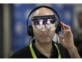 Yaron Asher tries out a virtual reality headset from start-up Mira Reality