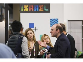 Attendees converse in the Israel section of the Eureka Park start-up area