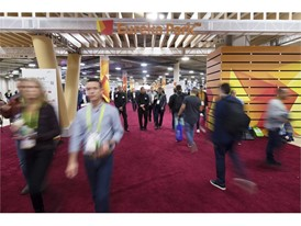 Attendees pass through the entry the Eureka Park start-up area during the first day of CES