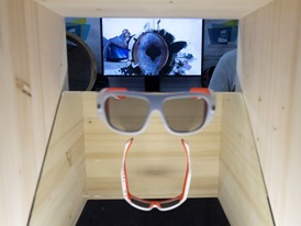 Glasses which film in 360 degrees, with footage displayed in the background, are seen during the first day of CES