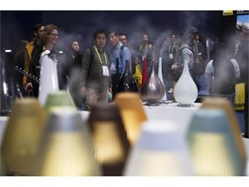 Attendees check out a line of diffusers during the second day of CES