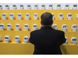 An attendee takes a photo of robots from Ling Technologies during the second day of CES