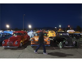 A spectator walks past a row of vintage vehicles during Mesquite Motor Mania