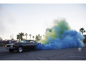 Tom Thiessen sends up clouds of yellow and blue smoke from the tires of his 1969 Camaro