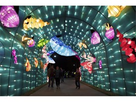 People stroll beneath an undersea display on the opening night of the China Lights lantern festival