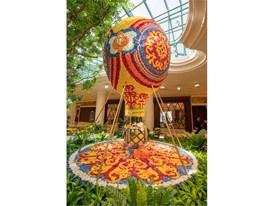 A balloon crafted of flowers decorates the Wynn atrium