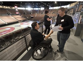 Las Vegas Aces Director of sales Aaron Johnson talks with a fan