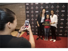 Lauren Mercado has her photo taken with Las Vegas Aces Kayla McBride, left, and Moriah Jefferson
