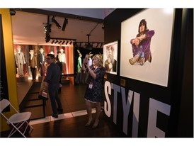 """Guests browse a collection of stage outfits at the Rolling Stones """"Exhibitionism"""""""