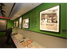 """Guests examine ephemera at the Rolling Stones """"Exhibitionism"""""""
