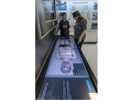 A guide describes one of the touch-screen interactive exhibits in the Crime Lab