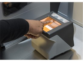 A fingerprint reader is used in the Crime Lab at the Mob Museum